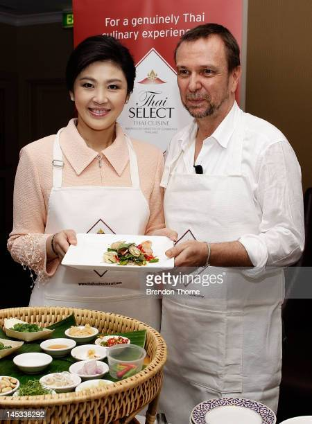 Prime Minister of Thailand Ms Yingluck Shanawatra poses with Australian chef David Thompson during a Thai food promotion and cooking demonstration at...