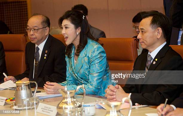 Prime Minister of Thailand Ms Yingluck Shanawatra talks with Australian Prime Minister Julia Gillard during a cabinet meeting at Parliament House on...