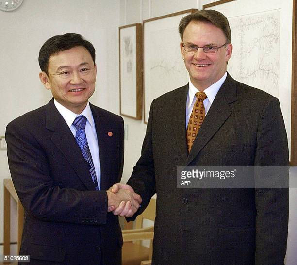Prime Minister of Thailand Thaksin Shinawatra meets opposition leader Mark Latham at the Parliament House in Canberra 05 July 2004 Thaksin witnessed...