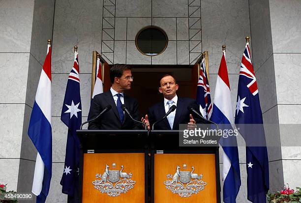Prime Minister of The Netherlands Mark Rutte listens to Australian Prime Minster Tony Abbott speak during a media conference at Parliament House...