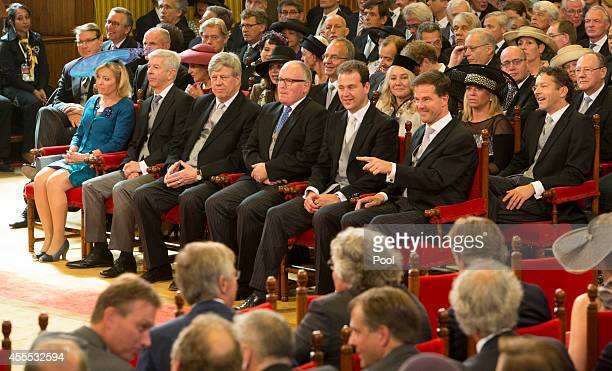 Prime Minister of the Netherlands Mark Rutte sits with government ministers as King WillemAlexander delivers an address on budget day in the Hall of...