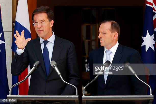 Prime Minister of The Netherlands Mark Rutte speaks as Australian Prime Minster Tony Abbott listens on during a media conference at Parliament House...