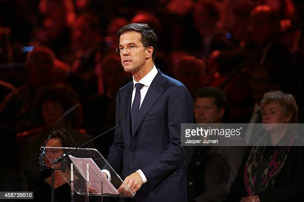 Prime Minister of the Netherlands Mark Rutte speaks as relatives and friends of the victims of the Malaysia Airlines Flight 17 disaster attend a...