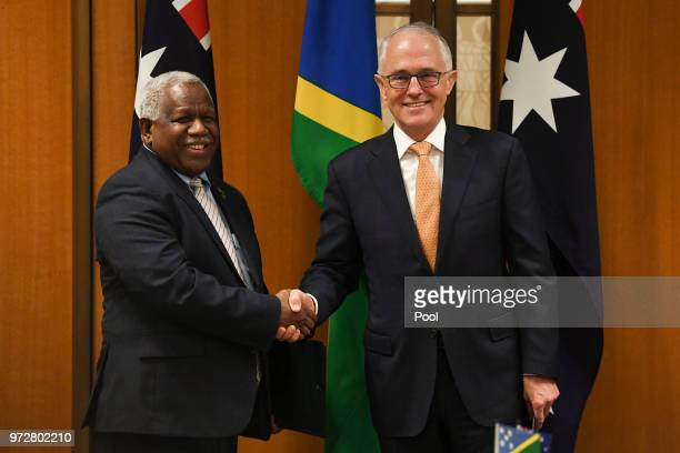 Prime Minister of the Solomon Islands Rick Houenipwela and Australian Prime Minister Malcolm Turnbull shake hands during a signing ceremony at...