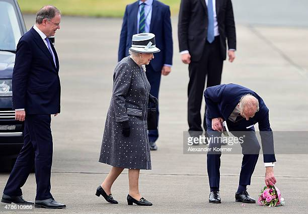 Prime Minister of the state of Lower Saxony Stephan Weil , Queen Elizabeth II and Prince Philip, Duke of Edinburgh, arrive at the military airport of...
