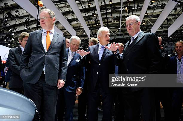 Prime Minister of the State of Lower Saxony Stephan Weil Wolfgang Porsche and Volkswagen Group CEO Martin Winterkorn arrive for the Volkswagen annual...