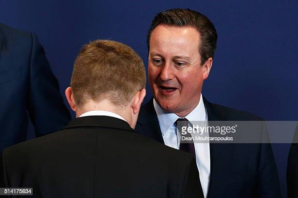 Prime Minister of the United Kingdom David Cameron and Prime minister of Slovakia Robert Fico speak during the family photo call at The European...