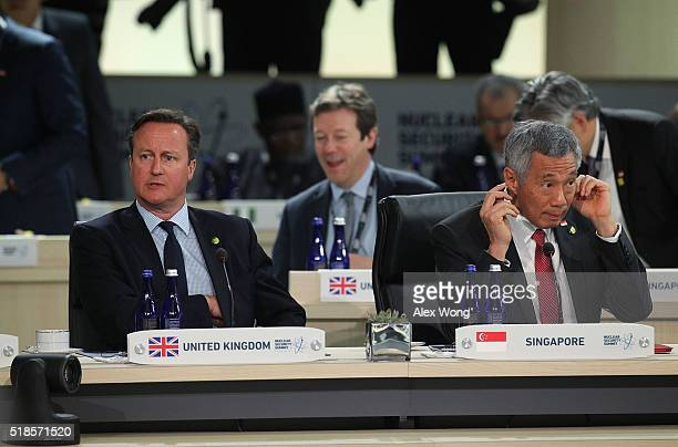 Prime Minister of the United Kingdom David Cameron and Prime Minister of Singapore Lee Hsien Loong listen during a plenary session of the 2016...