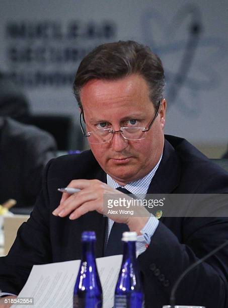 Prime Minister of the United Kingdom David Cameron listens during a plenary session of the 2016 Nuclear Security Summit April 1, 2016 in Washington,...
