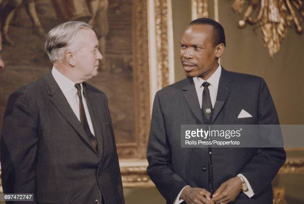 Prime Minister of the United Kingdom Harold Wilson on left talks with President of Botswana Seretse Khama at the 1969 Commonwealth Prime Ministers'...