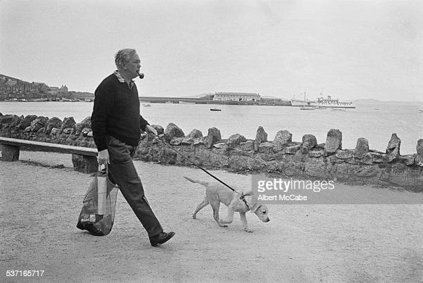 Prime Minister of the United Kingdom Harold Wilson with his dog 'Paddy' on holiday on the Isles of Scilly Great Britain 1967