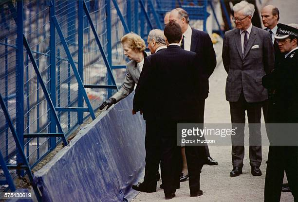 Prime Minister of the United Kingdom, Margaret Thatcher , visiting Hillsborough Stadium in Sheffield, the day after the stampede which resulted in...