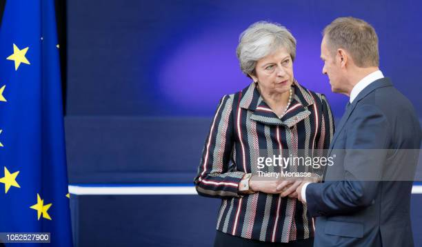 Prime Minister of the United Kingdom Theresa May talks with the President of the European Council Donald Franciszek Tusk after the family photo of...