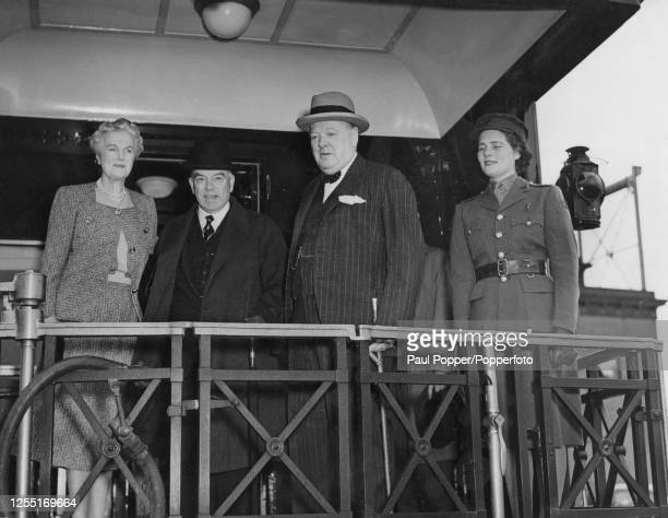 Prime Minister of the United Kingdom Winston Churchill stands in centre with, from left, Clementine Churchill , Prime Minister of Canada William Lyon...