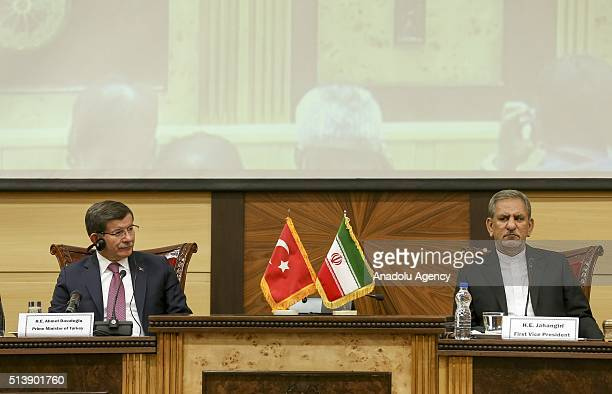 Prime Minister of Turkey Ahmet Davutoglu and First VicePresident of Iran Eshaq Jahangiri attend Turkey Iran Business forum in Tehran Iran on March 5...