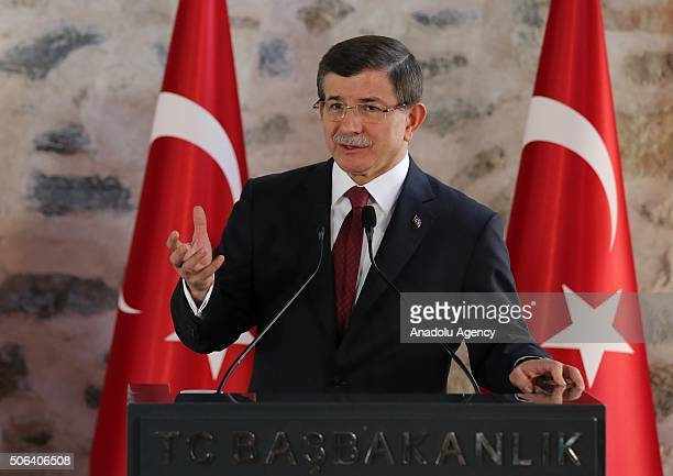 Prime Minister of Turkey Ahmet Davutoglu gestures during a press conference with Vice President of the United States Joe Biden after their meeting at...