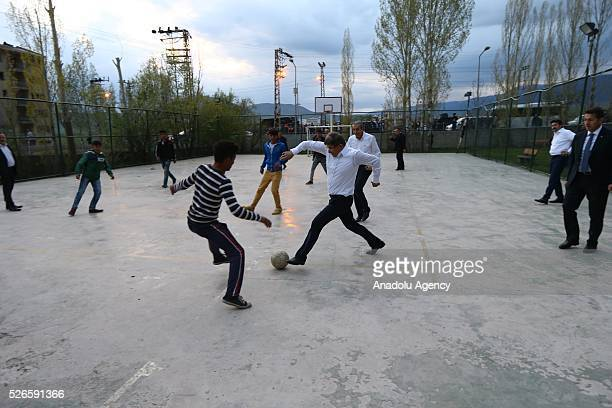 Prime Minister of Turkey Ahmet Davutoglu plays football with children at schoolyard in Varto district of Turkey's Mus on April 30 2016