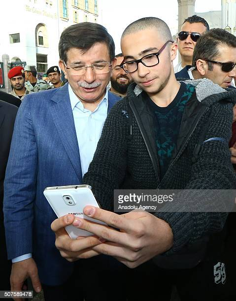 Prime Minister of Turkey Ahmet Davutoglu poses for a photograph in Medina Saudi Arabia on January 30 2016 during his visit at AlMasjid anNabawi...
