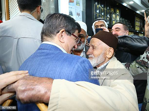 Prime Minister of Turkey Ahmet Davutoglu talks with an elder man in Medina Saudi Arabia on January 30 2016 during his visit at AlMasjid anNabawi...