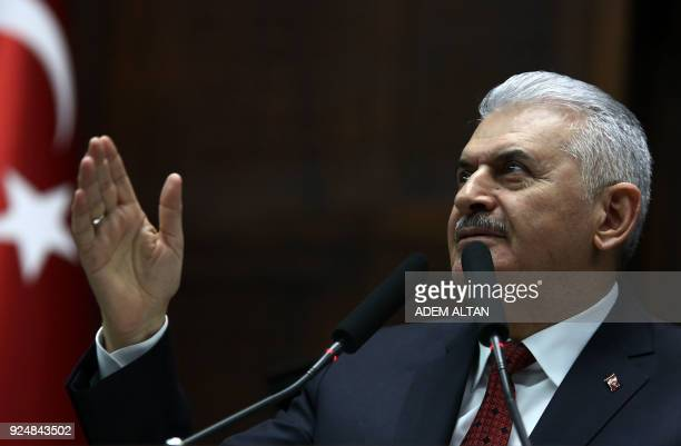 Prime Minister of Turkey and Vice Chairman of Turkey's ruling Justice and Development Party Binali Yildirim raises his hands as he delivers a speech...