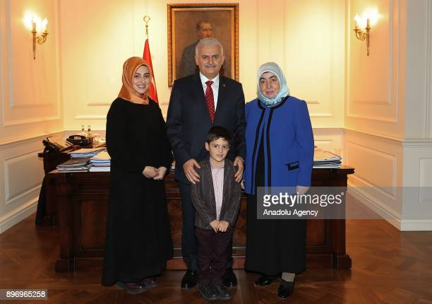 Prime Minister of Turkey Binali Yildirim and his wife Semiha Yildirim pose for a photo with 7 years old Alparslan and his mother Mehtap Nur Kazanci...