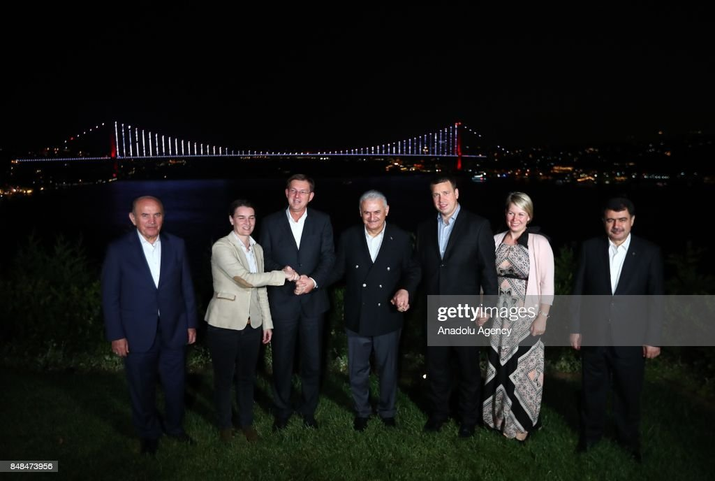 Prime Minister of Turkey Binali Yildirim (C), Estonia's Prime Minister Juri Ratas (3rd R) and his wife Karin Ratas (2nd R), Prime Minister of Serbia Ana Brnabic (2nd L) and Prime Minister of Slovenia Miro Cerar (3rd L) pose for a photo in front a scene of the Bosphorus at the historical Vahdettin Mansion in Istanbul, Turkey on September 17, 2017. The leaders meet together prior to watch the Eurobasket 2017 final match between Slovenia and Serbia which will be played today.
