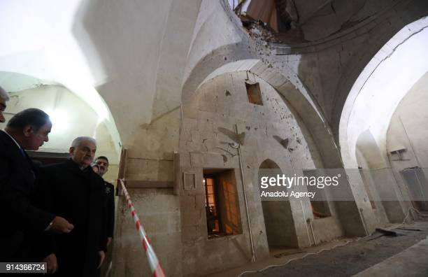 Prime Minister of Turkey Binali Yildirim inspects the Calik Mosque after a rocket fired by PYD/PKK terrorists from Syria hit the three centuries old...