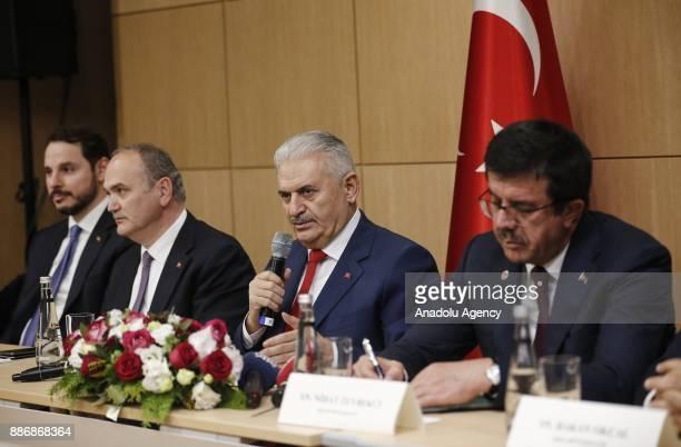 Prime Minister of Turkey Binali Yildirim Turkish Minister of Science Industry and Technology Faruk Ozlu Turkish Economy Minister Nihat Zeybekci and...