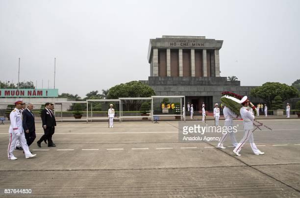 Prime Minister of Turkey Binali Yildirim walks towards the Ho Chi Minh Mausoleum behind a wreath in Hanoi Vietnam on August 23 2017