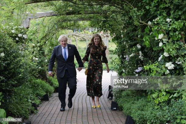 Prime Minister of United Kingdom, Boris Johnson and his wife Carrie Johnson arrive to attend a reception at The Eden Project during the G7 Summit on...