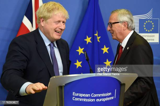 Prime Minister of United Kingdom Boris Johnson and Jean Claude Juncker President of European Commission leave the press conference to the European...