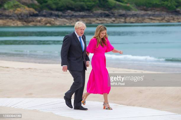 Prime Minister of United Kingdom, Boris Johnson and wife Carrie Johnson chat during the Leaders official welcome and family photo during the G7...