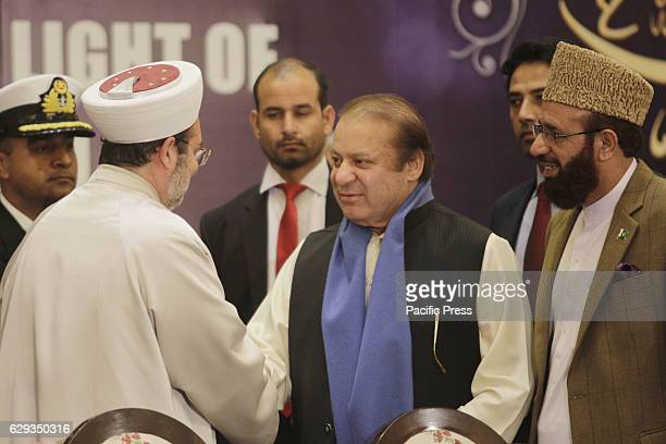 Prime Minister Pakistan Mian Muhammad Nawaz Sharif shakes hands with Turkish Head of the Religious Affairs Directorate Mehmet Gormez during Seerat...