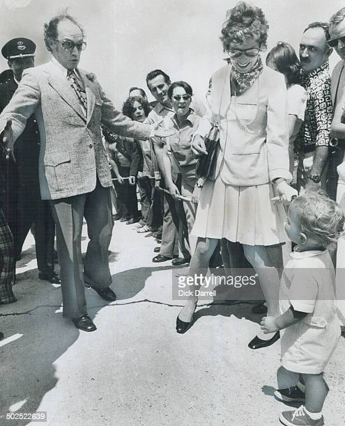 Prime Minister Pierre Trudeau clowns for the amusement of his son Justin Saturday after seeing off the Queen and Prince Philip at Ottawa while Mrs...