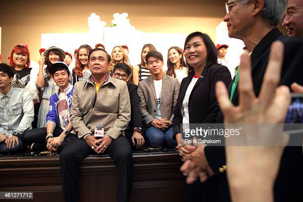 Prime Minister Prayut Chanocha pose for photograph with youths during National Children's Day at The Government House in Bangkok The National...