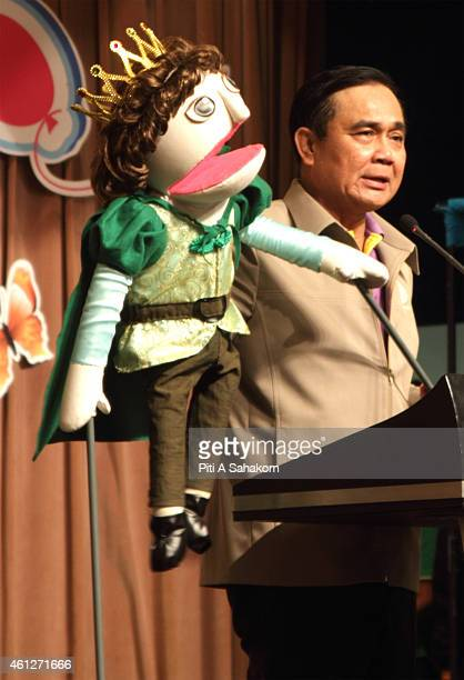 Prime Minister Prayut Chanocha use a puppet to speak with children during National Children's Day at The Government House in Bangkok The National...