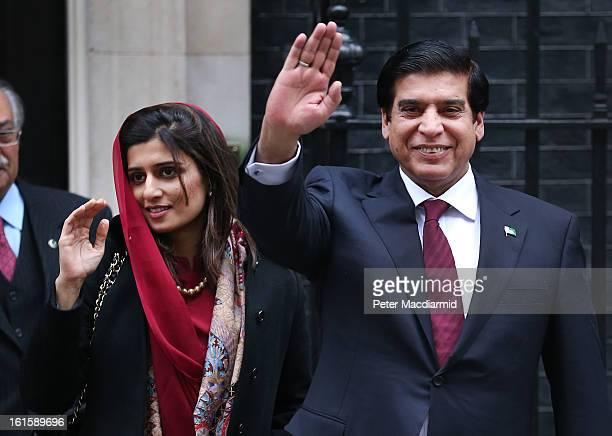 Prime Minister Raja Pervez Ashraf of Pakistan waves to reporters as he leaves 10 Downing Street with Pakistani Foreign Minister Hina Rabbani Khar...