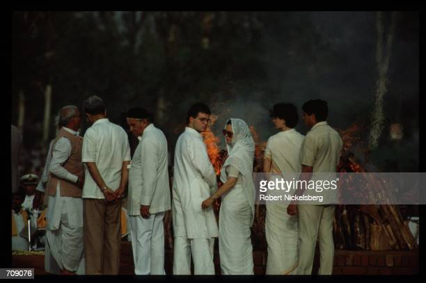 Prime Minister Rajiv Gandhis wife Sonia daughter Priyanka and son Rahul watch the pyre burn May 24 1991 in New Delhi India Gandhi was assassinated in...