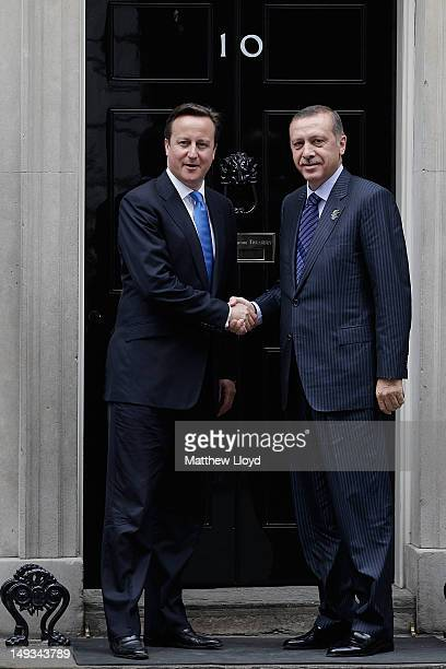Prime Minister Recep Tayyip Erdogan of Turkey is greeted by Prime Minister David Cameron at 10 Downing Street on July 27 2012 in London United...
