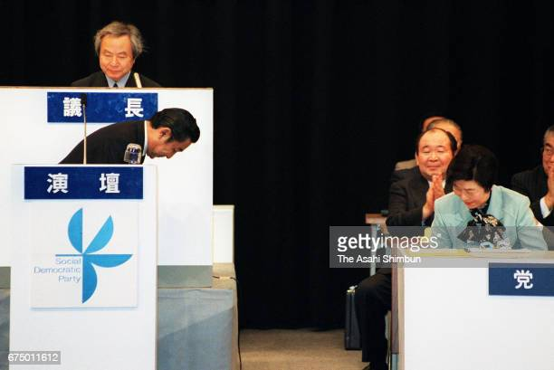Prime Minister Ryutaro Hashimoto bows to Social Democratic Party leader Takako Doi after addressing during the SDP annual convention on April 19 1997...