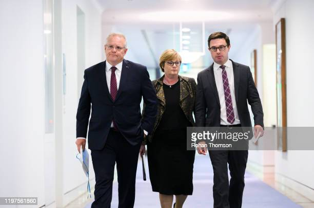 Prime Minister Scott Morrison alongside Defence Minister Linda Reynolds and Water Resources Minister David Littleproud at Parliament House on January...