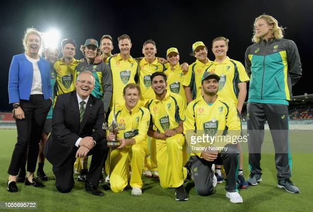 Prime Minister Scott Morrison and Deputy Nationals leader Bridget McKenzie with the Australian team after they won the One Day International warm up...