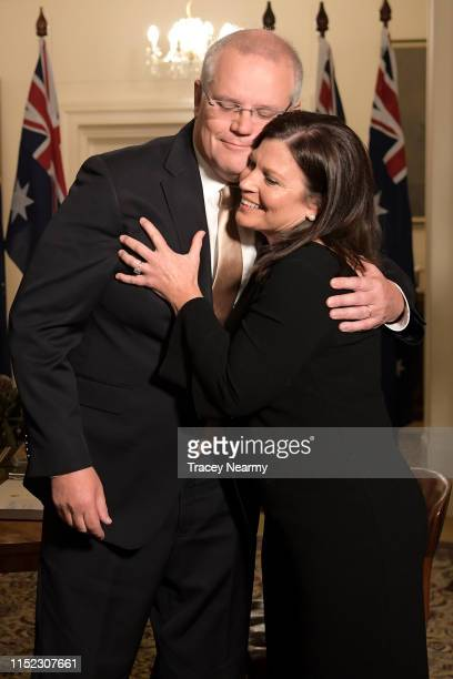 Prime Minister Scott Morrison and his wife Jenny Morrison embrace during the swearingin ceremony at Government House on May 29 2019 in Canberra...