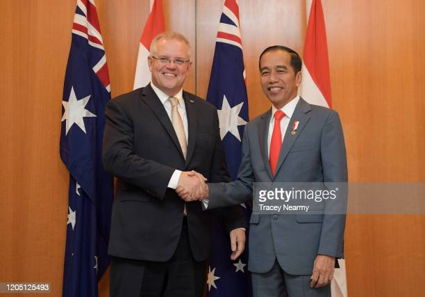 Prime Minister Scott Morrison and Indonesian President Joko Widodo shake hands before a discussion with Ministers in the Cabinet Room at Parliament...
