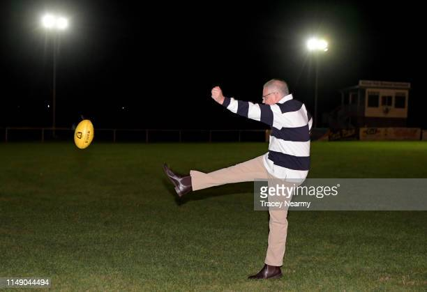 Prime Minister Scott Morrison kicks a football as he visits Bridgenorth FC the seat of Bass on May 14 2019 in Launceston Australia The government is...