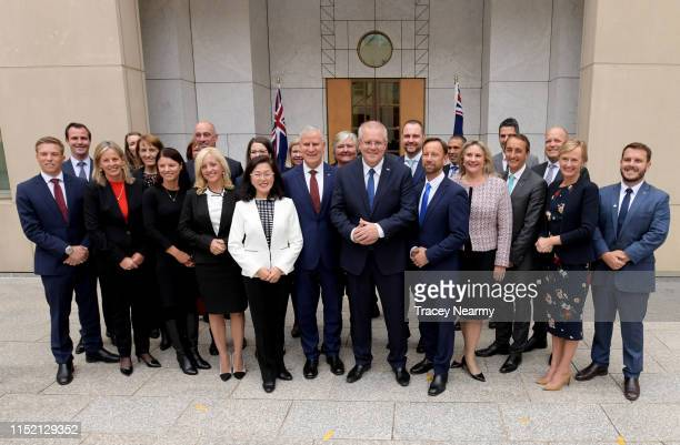 Prime Minister Scott Morrison poses for photographs with incoming Government Members & Senators after a Joint Party Room meeting at Parliament House...