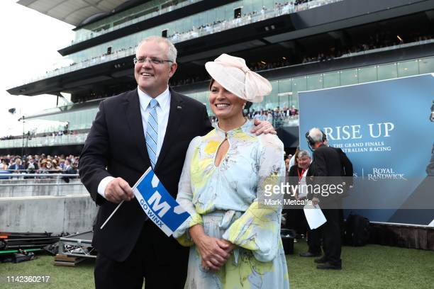 Prime Minister Scott Morrison poses with his wife Jenny as they attend The Championships Day 2 at Royal Randwick Racecourse on April 13, 2019 in...