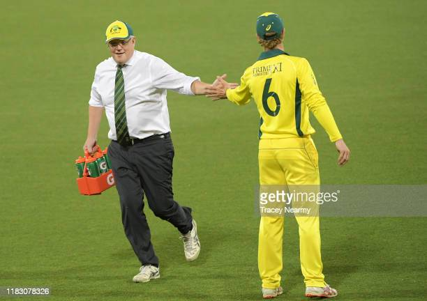 Prime Minister Scott Morrison runs water during the tour match between Prime Ministers XI and Sri Lanka at Manuka Oval on October 24, 2019 in...