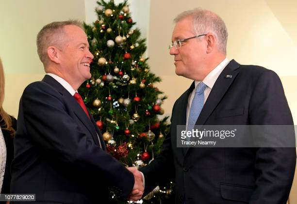 Prime Minister Scott Morrison shakes hands with the Opposition Leader Bill Shorten at the Kmart Wishing Tree Salvation Army Present Collection at...