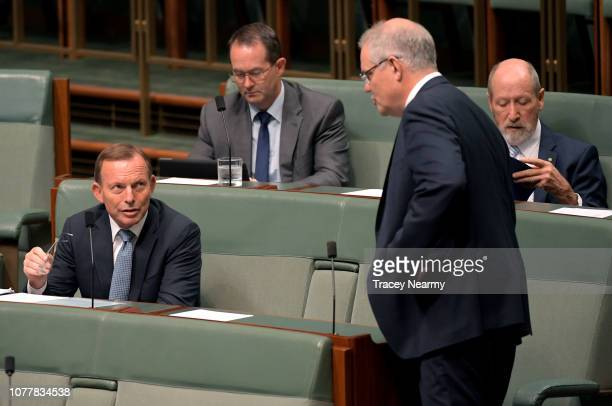 Prime Minister Scott Morrison speaks to former Prime Minster Tony Abbott ahead of Question Time at Parliament House on December 06 2018 in Canberra...
